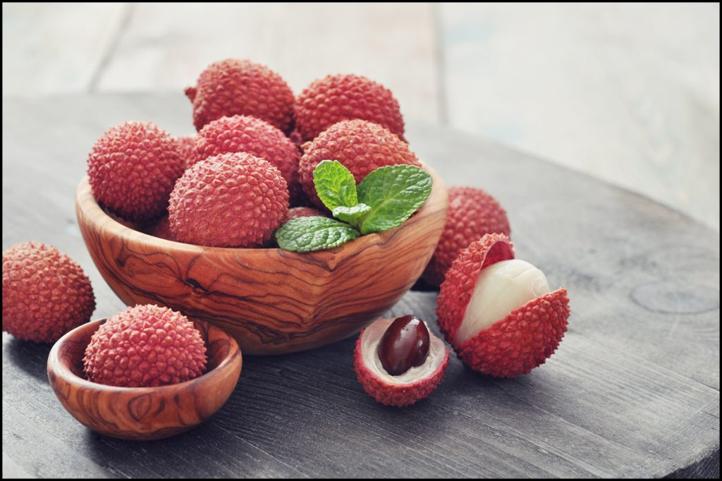 fresh-lychee-in-bowl-on-a-wooden-background
